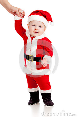 First steps of cute baby boy Santa Claus