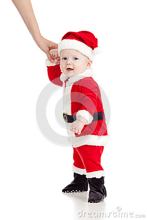 First steps of Santa Claus baby boy. Studio shot