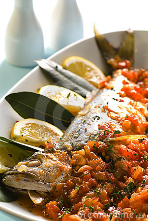 Fish baked with tomato sauce