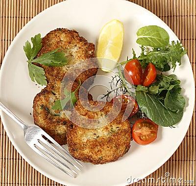 Fish cakes and salad high angle