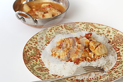 Fish curry and serving bowl horizontal