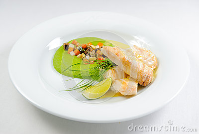 Fish fillet with sauce and vegetables