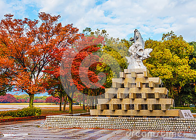 Fish fountain at Hiroshima central Park in Autumn
