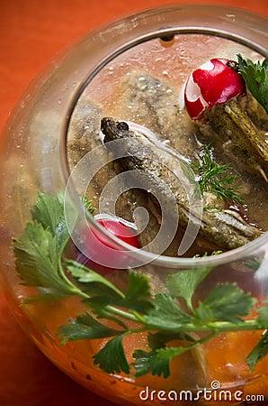 Fish in glass bowl dish