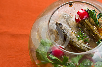 Fish in glass bowl dish