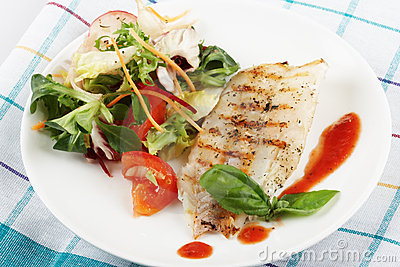 Fish grill with salad