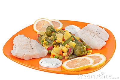 Fish and mixed vegetables on plate