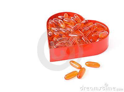 Fish oil pills in red heart shaped box