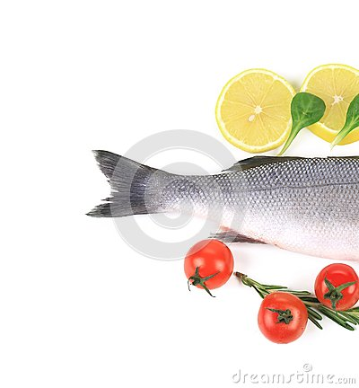 Fish on a plate with vegetables and lemon