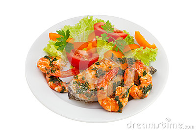 Fish with seafood and salad on the plate