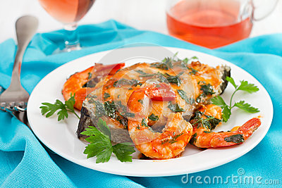 Fish with shrimps and parsley