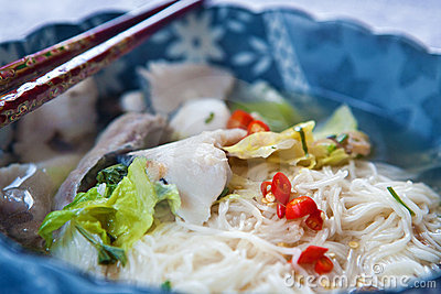 Fish soup with noodles and lettuce