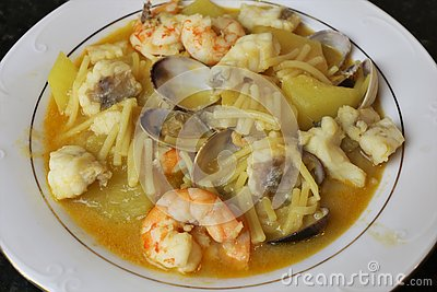 Fish stew with prawns and clams
