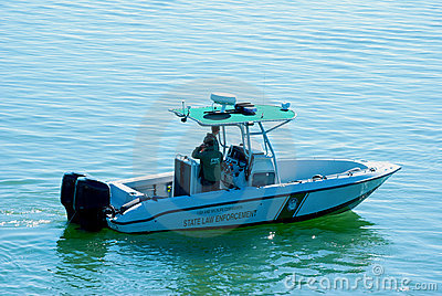 Fish and Wildlife Commission boat on patrol Editorial Photo