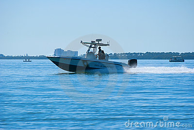 Fish and Wildlife officers on boat patrol Editorial Stock Photo