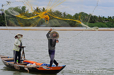 Fisher casting his net Editorial Stock Image
