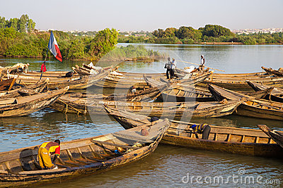 Fisher men working in their boat on the Niger River Editorial Image