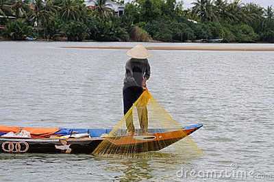 Fisher pulling up his net with his catch Editorial Photo
