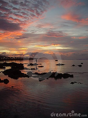 Fisher in a Reunion Island sunrise