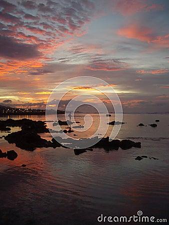 Fisher in a Reunion Island sunrise