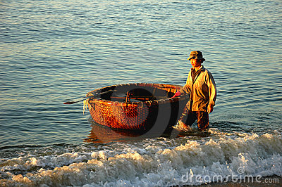 Fisherman with basket boat in Vietnam Editorial Image