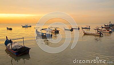 Fisherman boat on sunset