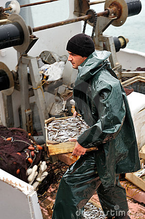 Free Fisherman Carrying Box With Fish Stock Photos - 7756533