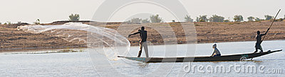 Fisherman casts a net on the Niger River, Mali. Editorial Stock Image