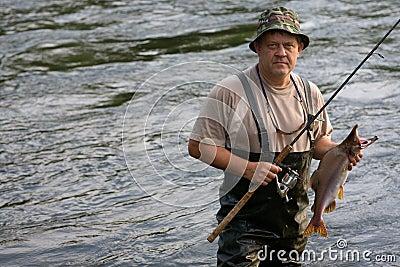 Fisherman caught a salmon