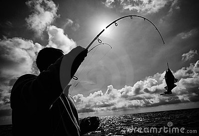 Fisherman and fish hooked