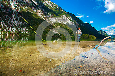 Fisherman fly fishing at lake Bohinj