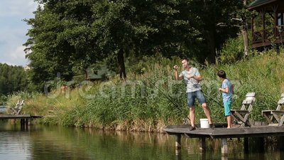 Fisherman getting ready for angling on the lake stock video footage