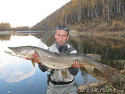 Fisherman with giant pike