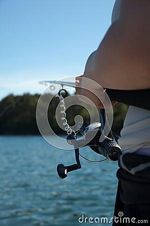 Fisherman holding rod