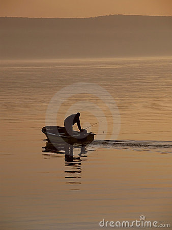 Free Fisherman In The Haze At Sea Royalty Free Stock Photography - 16838097