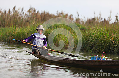 Fisherman on Inle lake rowing his canoe on the wat Editorial Image