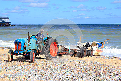 Fisherman loading his boat. Editorial Stock Photo