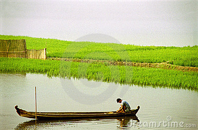 Fisherman on river in boat