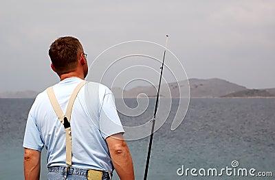 Fisherman at sea fishing