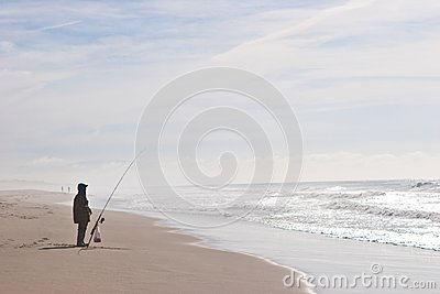 Fisherman at the shore of the ocean