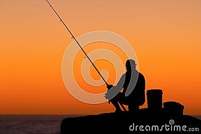 Fisherman Silhouette against Sunrise