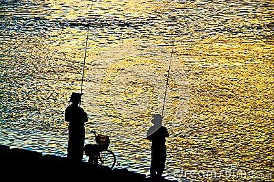 Fisherman silhouette  on shoreline