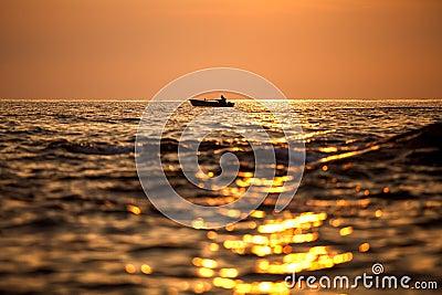 Fisherman silhouette on sunrise, Thailand