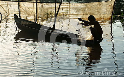 Fisherman Sitting On Row Boat, Pick Up The Net Stock Photo ...
