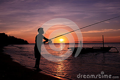 Fisherman at Sunrise Editorial Photo