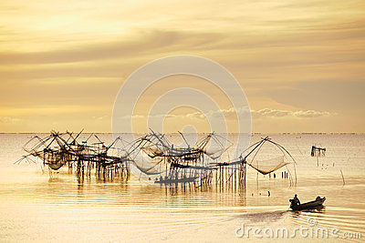 The fisherman in sunrise