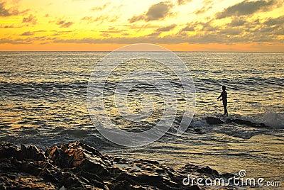 Fisherman and sunset beach