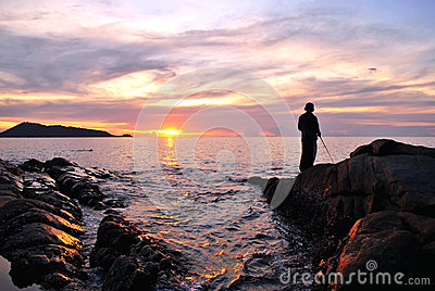 Fisherman and sunset beach