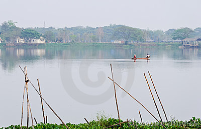 Fisherman in tranquil lake