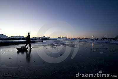 Fisherman Walking on Ice to Catch Fish